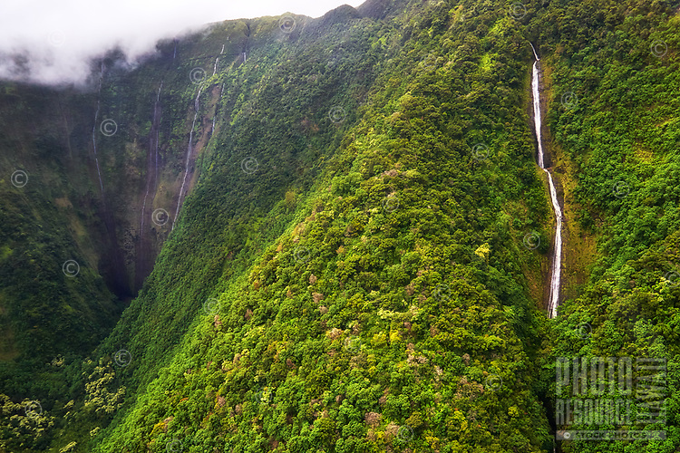 A helicopter tour view of the waterfalls at the back of Waimanu Valley, Hamakua Coast, Big Island.