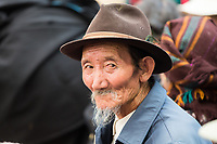 A man in the 'Jewel Park' (Norbulinka, in Tibetan) in central Lhasa. Each year, families meet in the park to watch traditional plays and dances as part of the Sho Dun festival which dates back to the 16th Century when people would gather to give food, especially yoghurt, to local monks.