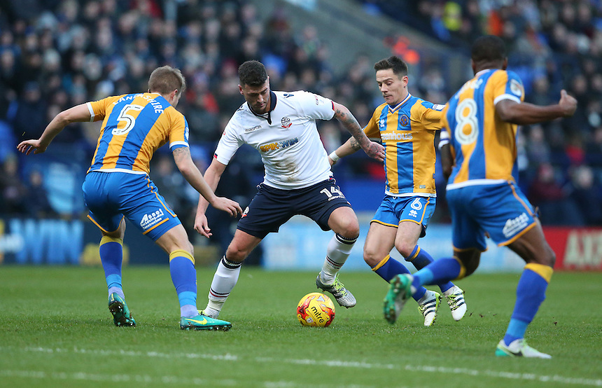 Bolton Wanderers' Gary Madine battles with Shrewsbury Town's Oliver Lancashire (left) and Ian Black (right)<br /> <br /> Photographer Stephen White/CameraSport<br /> <br /> The EFL Sky Bet League One - Bolton Wanderers v Shrewsbury Town - Monday 26th December 2016 - Macron Stadium - Bolton<br /> <br /> World Copyright &copy; 2016 CameraSport. All rights reserved. 43 Linden Ave. Countesthorpe. Leicester. England. LE8 5PG - Tel: +44 (0) 116 277 4147 - admin@camerasport.com - www.camerasport.com