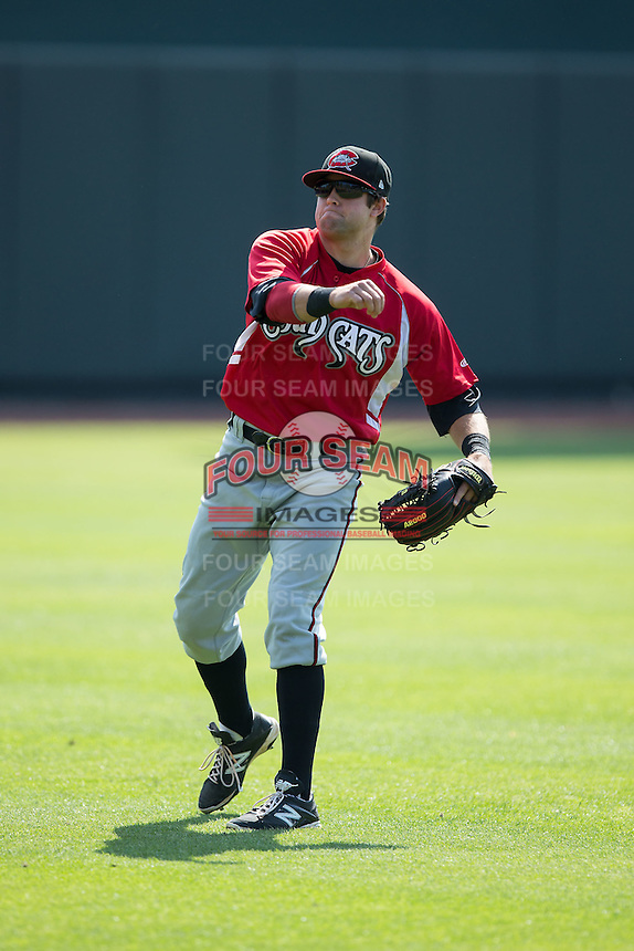 Connor Oliver (11) of the Carolina Mudcats warms up in the outfield prior to the game against the Winston-Salem Dash at BB&T Ballpark on April 22, 2015 in Winston-Salem, North Carolina.  The Dash defeated the Mudcats 4-2..  (Brian Westerholt/Four Seam Images)