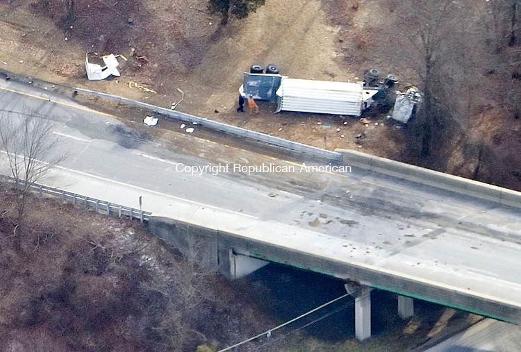 MIDDLEBURY, CT- 12 FEBRUARY 2008- 021208JT07-<br /> Workers inspect an overturned tractor-trailor containing compressed hydrogen that flipped over Interstate 84 in Middlebury Tuesday morning, closing the east-and west-bound lanes of the highway for several hours as crews worked to clean the area.<br /> Josalee Thrift / Republican-American