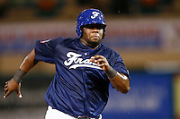 21 September 2012: Rene Leveret runs to third base during France vs South Africa tie game 2-2, rain delayed at the end of the 9th inning at 1 AM, during the 2012 World Baseball Classic Qualifier round, in Jupiter, Florida, USA. Game to resume 22 September 2012 at noon.