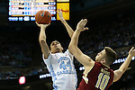 30 January 2016: North Carolina's Justin Jackson (44) shoots over Boston College's Ervins Meznieks (LVA) (10). The University of North Carolina Tar Heels hosted the Boston College Eagles at the Dean E. Smith Center in Chapel Hill, North Carolina in a 2015-16 NCAA Division I Men's Basketball game. UNC won the game 89-62.