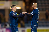 10th March 2020; Dens Park, Dundee, Scotland; Scottish Championship Football, Dundee FC versus Ayr United; Josh Meekings and Jordon Forster of Dundee fist bump at the end of the match after their 0-2 win