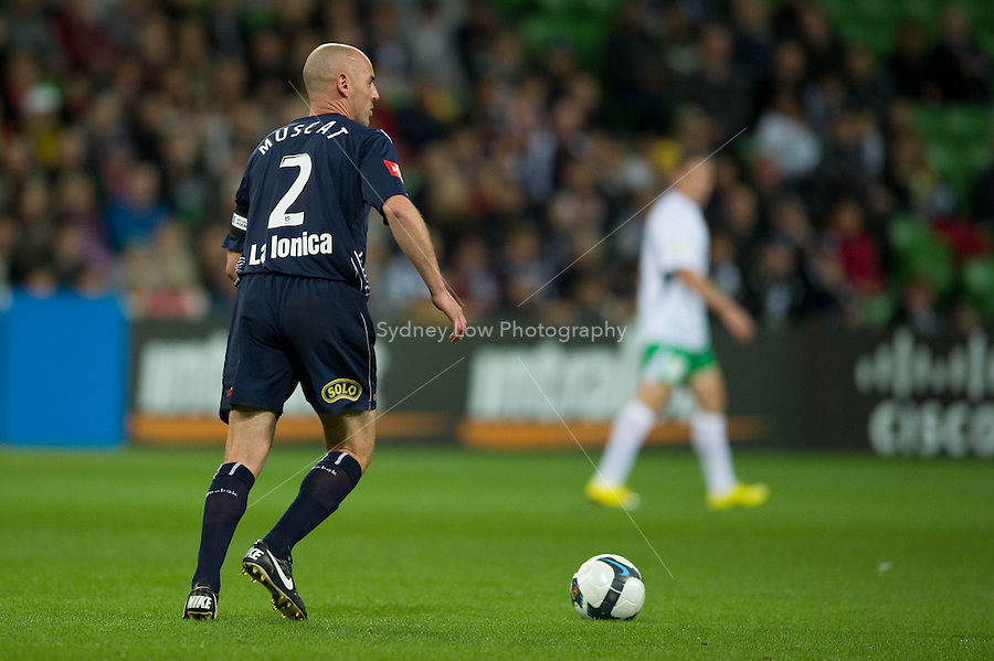 MELBOURNE, AUSTRALIA - May 14, 2010: Kevin Muscat from Melbourne Victory controls the ball in Kevin Muscat Testimonial match between the Melbourne Victory and Come Play XI at AAMI Park on May 14, 2010 in Melbourne, Australia. Photo Sydney Low www.syd-low.com