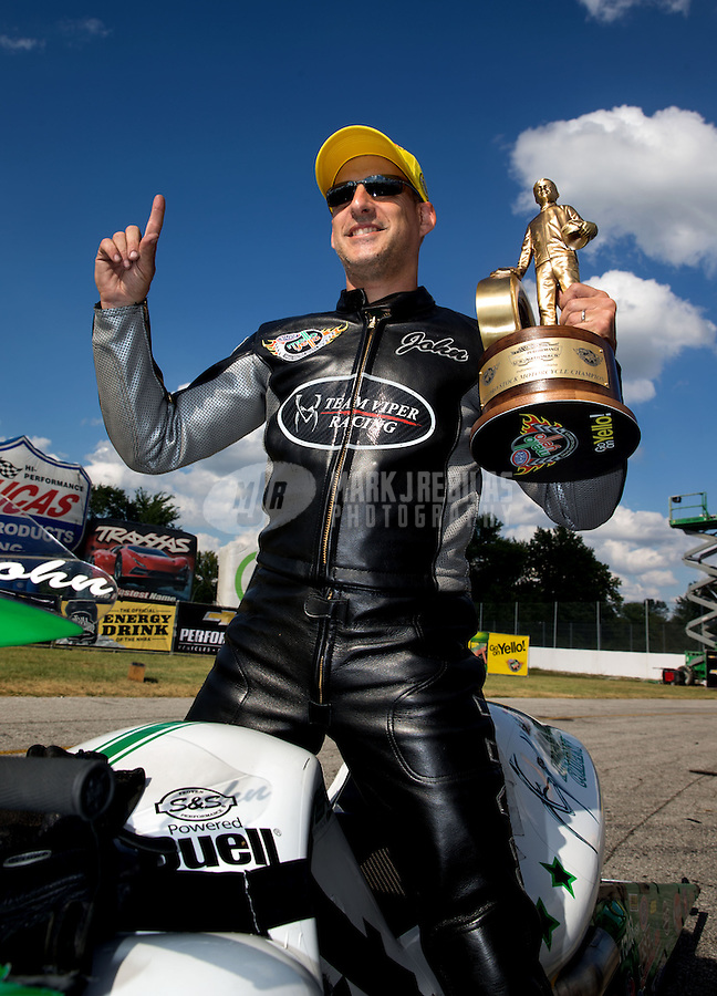 Sept. 2, 2013; Clermont, IN, USA: NHRA pro stock motorcycle rider John Hall celebrates after winning the US Nationals at Lucas Oil Raceway. Mandatory Credit: Mark J. Rebilas-