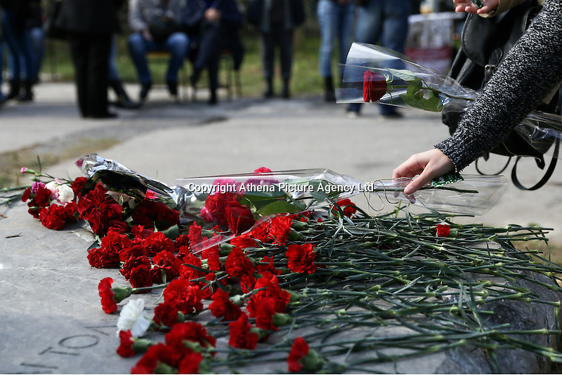 Pictured: Carnations left at the uprising monument at the Athens Polytechinc in Athens Greece. Wednesday 16 November 2016<br /> Re: 43rd anniversary of the Athens Polytechnic uprising of 1973 which was a massive demonstration of popular rejection of the Greek military junta of 1967–1974. The uprising began on November 14, 1973, escalated to an open anti-junta revolt and ended in bloodshed in the early morning of November 17 after a series of events starting with a tank crashing through the gates of the Polytechnic.