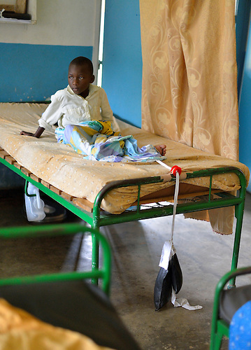 A boy healing from  a leg fracture in the surgery ward of Kibuye Hospital, Karongi District, Western Rwanda.