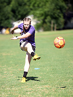 NWA Democrat-Gazette/FLIP PUTTHOFF <br /> SUMMER SOCCER<br /> Abigail Howard, a recent graduate of Providence Academy in Rogers, hones her soccer skills on Tuesday June 25 2019 with other players in Bentonville. The girls were training with soccer coach Gum Mpwo (cq) at a field near the Bentonville School District administarion building.