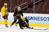 Justin Kloos (MN - 25), ?, Travis Boyd (MN - 22) - The University of Minnesota Golden Gophers practiced on Wednesday, April 9, 2014, at the Wells Fargo Center during the 2014 Frozen Four in Philadelphia, Pennsylvania.