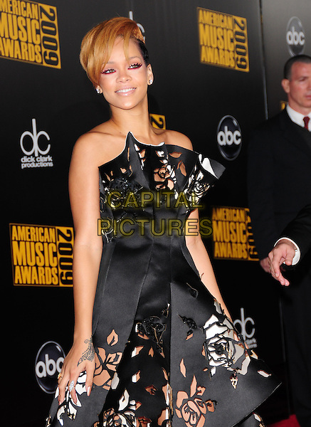 RIHANNA (Robyn Rihanna Fenty).The 2009 American Music Awards held at The Nokia Theatre L.A. Live in Los Angeles, California, USA. .November 22nd, 2009.AMA AMA's half length black white strapless dress cut out away perforated floral print couture .CAP/RKE.©DVS/RockinExposures/Capital Pictures