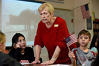 NWA Democrat-Gazette/DAVID GOTTSCHALK Bonnie Cherry, a retired school teacher whose father served in World War I, speak with fourth grade students in Kacee Scott's class Friday, November 1, 2019, at Hunt Elementary School in Springdale. Hunt spoke to the children about the history of the poppy flower, the significance of the W.W.I and Veterans Day. Cherry, along with Dorothy Cardiel, a veteran and member of the VFW Auxillary 2952, handed out stickers, U.S. flags and a poppy flower.