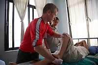Mark Weeds, an NHS physiotherapist from Llanelli who is helping assess and treat people who suffered spinal injuries in the earthquake which struck Nepal on 25 April 2015.<br /> <br /> &quot;This is the first time I've been deployed as part of the UK EMT&quot;, says Mark. <br /> <br /> &quot;We highlighted a need for physiotherapy here in the spinal injuries clinic, so we've been helping the Nepalese physiotherapists here with the treatment and assessment of people who've been injured in the earthquake.&quot;<br /> <br /> &quot;The Nepalese people have been so friendly and helpful to us, despite their current problems.<br /> <br /> &quot;I wouldn't like to think this kind of thing will happen again, but at least if it does, and I was deployed again, I think I've gained some really good experience and would be ready to help again&quot;.<br /> <br /> Mark was deployed to Nepal as part of the UK's Emergency Medical Team, as he is on the UK International Emergency Trauma Register, which is funded by the Department for International Development.<br /> <br /> Picture: Russell Watkins/DFID