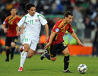 Santi Cazorla (right) of Spain and Hawar Mulla Mohammed (11) of Iraq. Spain defeated Iraq 1-0 during the FIFA Confederations Cup at Free State Stadium, in Mangaung/Bloemfontein South Africa on June 17, 2009.