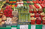 Large variety of vegetables in fresh produce display at farmers market.