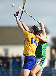 Colin Guilfoyle of Clare in action against Josh Adams of Limerick during their Munster U-21 hurling quarter final at Cusack park. Photograph by John Kelly.