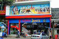 Indonesia, Java, Bandung. The famous Jalan Jeans, Jeans Street, in Bandung. Cheap locally made cloths for sale.
