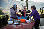Mother (L), daughter (C) and mother-in law (R) make blood sausages in traditional way pig slaughtering. Legasa (Basque Country). January 7, 2017. The slaughter traditionally takes place in the autumn and early winter and the work often is done in the open. (Gari Garaialde / Bostok Photo)