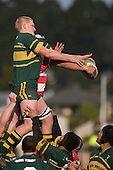 J. Chipman does his best to disrupt lineout ball for S. Poching. Counties Manukau Premier McNamara Cup rugby game between Pukekohe & Karaka played at Colin Lawrie Fields Pukekohe on July 14th, 2007. Pukekohe won 31 - 29.