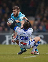 Exeter Chiefs' Luke Cowan-Dickie evades the tackle of Castres Rory Kockott<br /> <br /> Photographer Bob Bradford/CameraSport<br /> <br /> European Rugby Heineken Champions Cup Pool 2 - Exeter Chiefs v Castres - Sunday 13th January 2019 - Sandy Park - Exeter<br /> <br /> World Copyright &copy; 2019 CameraSport. All rights reserved. 43 Linden Ave. Countesthorpe. Leicester. England. LE8 5PG - Tel: +44 (0) 116 277 4147 - admin@camerasport.com - www.camerasport.com
