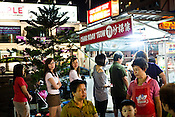 Locals wait for their turn at Penang's famous Char Koay Teow stall in Gurney Drive, Georgetown in Penang, Malaysia. Photo: Sanjit Das/Panos