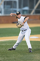 Wake Forest Demon Deacons third baseman Will Craig (22) makes a throw to first base against the Georgetown Hoyas at David F. Couch Ballpark on February 19, 2016 in Winston-Salem, North Carolina.  The Demon Deacons defeated the Hoyas 3-1.  (Brian Westerholt/Four Seam Images)