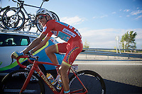 The man in red (race leader) Fabio Aru (ITA/Astana) passing by the teamcars to say hello on his customised (red/gold) Specialized S-Works on the last stage into Madrid<br /> <br /> stage 21: Alcala de Henares - Madrid (98km)<br /> 2015 Vuelta à Espana
