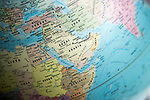 Middle East map on a globe focused on Saudi Arabia
