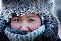 A portrait of a women working at the Yakutsk outdoor fish market. Yakutsk is one of the coldest cities on earth, with winter temperatures averaging -40.9 degrees Celsius.