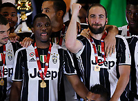 Gonzalo Higuain  of Juventus  celebrate after win    Italy Cup Final  football match against SS Lazio at  the Olympic stadium in Rome, Italy   17  May 2017
