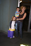 "Liz Kiefer (Blake) with her children Kiefer and Ilisabella at their ""Bloss and Friends"" bowling event at the Port Authority Bowling lanes to benefit the Cancer Foundation on October 9, 2004 (Photo by Sue Coflin)"