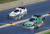 Jul, 21, 2012; Morrison, CO, USA: NHRA funny car driver John Force (near lane) races alongside Mike Neff during qualifying for the Mile High Nationals at Bandimere Speedway. Mandatory Credit: Mark J. Rebilas-US PRESSWIRE