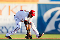 Renny Osuna (13) of the Frisco RoughRiders fields a ground ball during a game against the North All-Stars 2011 in the Texas League All-Star game at Nelson Wolff Stadium on June 29, 2011 in San Antonio, Texas. (David Welker / Four Seam Images)..