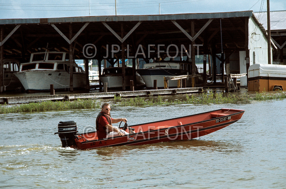 Houston, Texas - May 6, 1977. Red Adair takes his boat out. Red Adair (June 18, 1915 - August 7, 2004) was an American oil well firefighter, who later became an innovator in the highly specialized profession of extinguishing and capping blazing or erupting oil well blowouts, both on land and offshore.