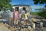A year after Hurricane Matthew destroyed much of the village of Citerne Remy in Haiti's poverty-wracked northwest, this family waits to move into their new house being built by Church World Service, a member of the ACT Alliance.