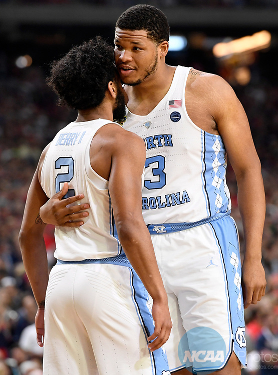 GLENDALE, AZ - APRIL 03: Kennedy Meeks #3 of the North Carolina Tar Heels embraces and encourages Joel Berry II #2 of the North Carolina Tar Heels during the 2017 NCAA Men's Final Four National Championship against the Gonzaga Bulldogs game at University of Phoenix Stadium on April 3, 2017 in Glendale, Arizona.  (Photo by Jamie Schwaberow/NCAA Photos via Getty Images)