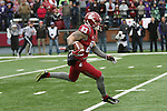 Kaleb Fossum, Washington State wide receiver and kick returner, brings the ball up field during the Cougars annual Apple Cup battle with rival Washington at Martin Stadium in Pullman, Washington, on November 25, 2016.