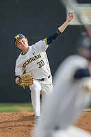 Michigan Wolverines pitcher Michael Hendrickson (30) warms up before the NCAA baseball game against the Michigan State Spartans on April 18, 2017 at Ray Fisher Stadium in Ann Arbor, Michigan. Michigan defeated Michigan State 12-4. (Andrew Woolley/Four Seam Images)