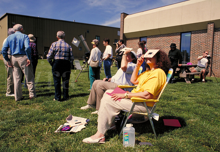 Watching a solar eclipse (annular type) with protective eyeglasses, celestial phenomena NR. Fort Scott Kansas.