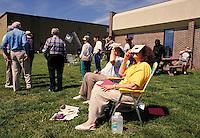 Watching a solar eclipse (annular type) with protective eyeglasses, celestial phenomena NR. Fort Scott Kansas.