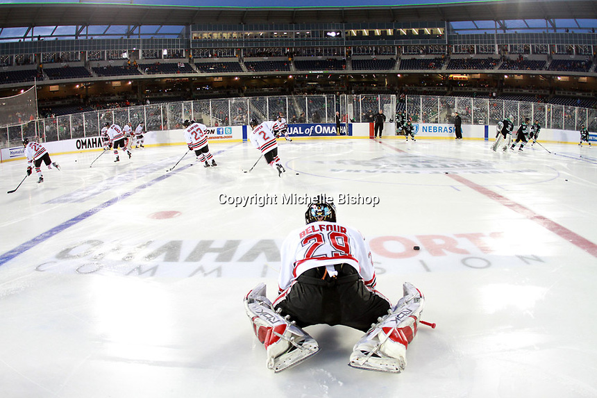 Nebraska-Omaha goalie Dayn Belfour stretches prior to the outdoor game against North Dakota at TD Ameritrade Park in Omaha, Neb., Saturday, Feb. 9, 2013. (Photo by Michelle Bishop)