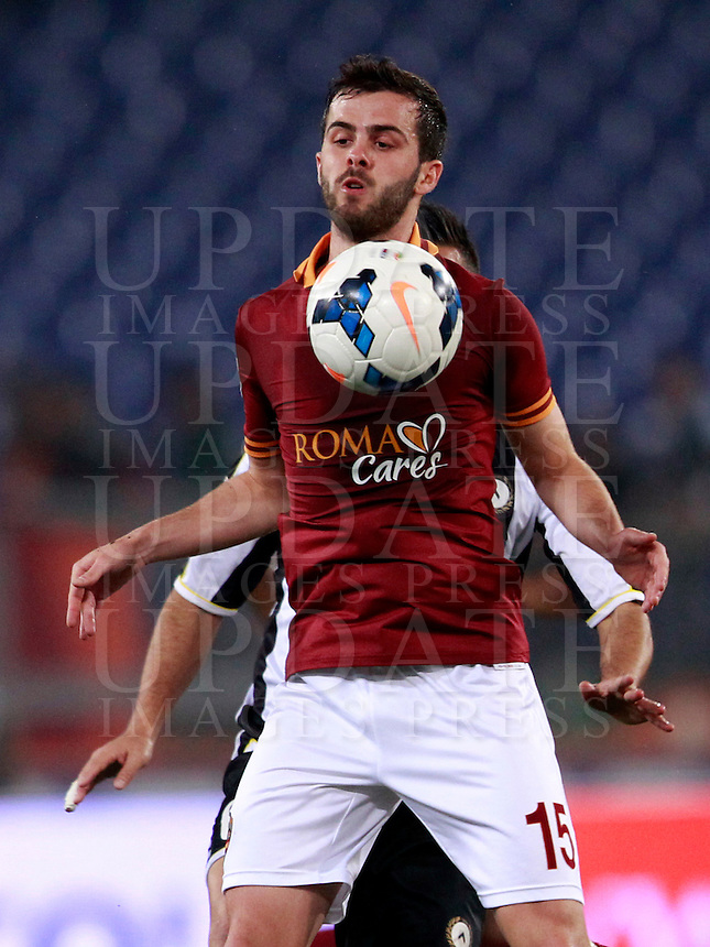 Calcio, Serie A: Roma vs Udinese. Roma, stadio Olimpico, 17 marzo 2014.<br /> AS Roma midfielder Miralem Pjanic, of Bosnia, stops the ball during the Italian Serie A football match between AS Roma and Udinese at Rome's Olympic stadium, 17 March 2014.<br /> UPDATE IMAGES PRESS/Isabella Bonotto