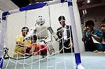 Fujitsu's HOAP-3 robot kicks a soccer ball at Robo Japan 2008 in Yokohama, Japan on Saturday 09 October 2008.