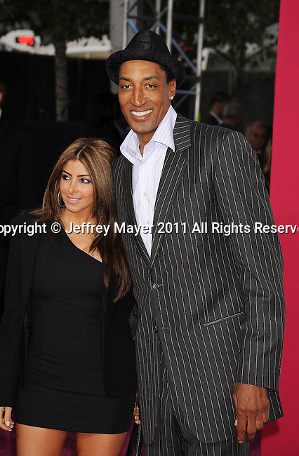 LOS ANGELES, CA - FEBRUARY 20: Scottie Pippen and Larsa Pippen arrive at the T-Mobile Magenta Carpet at the 2011 NBA All-Star Game at L.A. Live on February 20, 2011 in Los Angeles, California.
