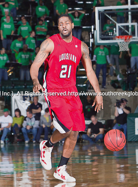 Louisiana Lafayette Ragin Cajuns forward Darshawn McClellan (21) in action during the game between the Louisiana Lafayette Ragin Cajuns and the University of North Texas Mean Green at the North Texas Coliseum,the Super Pit, in Denton, Texas. Louisiana Lafayette defeats UNT 57 to 53.