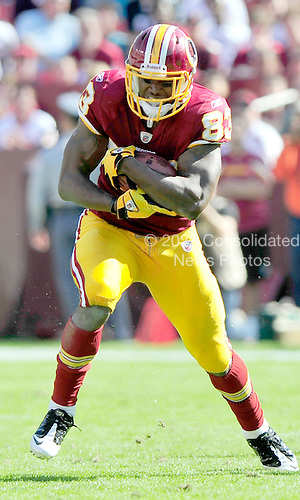 Washington Redskins tight end Fred Davis (83) carries the ball after making a catch against the Philadelphia Eagles at FedEx Field in Landover, Maryland on Sunday, October 16, 2011.  The Eagles won the game 20 - 13..Credit: Ron Sachs / CNP