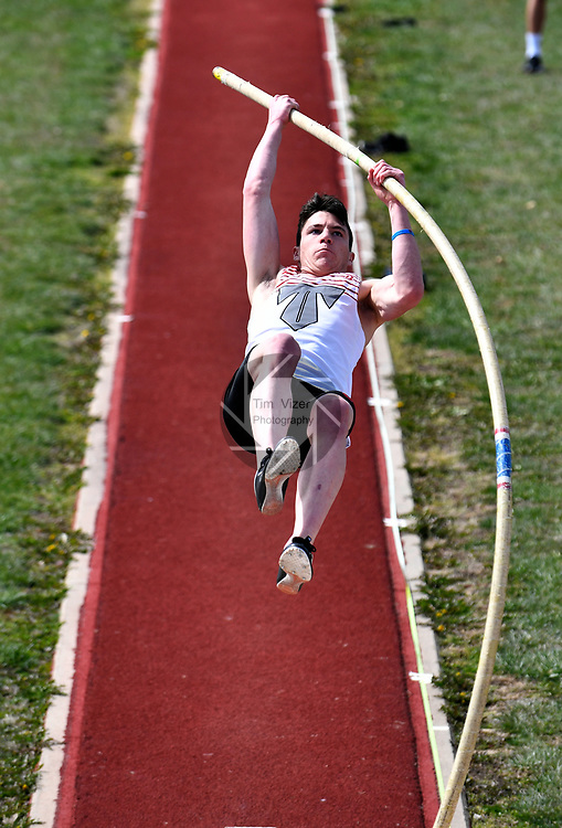 Triad High School pole vaulter Jadon Elliott at the Norm Armstrong Boys Track and Field Invitational on Wednesday April 11, 2018. Photo by Tim Vizer