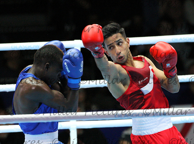 Qais Ashfaq of Team England in the red vest against Benson Gicharu Njangiru of Team Kenya in the Men's Bantamweight Semi Final bout  in the Boxing for the 20th Commonwealth Games, Glasgow 2014 at the Scottish Exhibition and Conference Centre, Glasgow on 1.8.14.