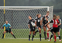 BOYDS, MARYLAND - July 21, 2012:  Molly Menchel (14), Hayley Siegel (12), and Jerica DeWolfe (20) of DC United Women block a free kick by Emily Kittleson (6) of the Virginia Beach Piranhas during a W League Eastern Conference Championship semi final match at Maryland Soccerplex, in Boyds, Maryland on July 21. DC United Women won 3-0.