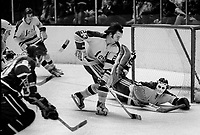 Seals vs Vancouver Ted McAneeley and Gilles Meloche save ..(1973 photo/Ron Riesterer)